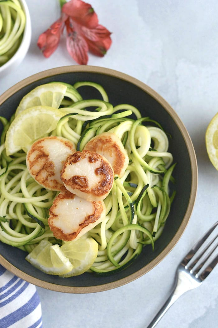 EASY Whole30 Lemon Garlic Scallops Zucchini Noodles with sautéed zucchini noodles. One pan and 10 minutes is what you need for this healthy, low carb meal. Paleo + Whole30 + Low Carb + Low Calorie + Gluten Free