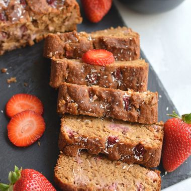 Gluten Free Strawberry Banana Bread! Made with Greek yogurt, packed with fresh berries and naturally sweetened with bananas and coconut flakes. The perfect bread for summer breakfast or snacks. Gluten Free + Low Calorie