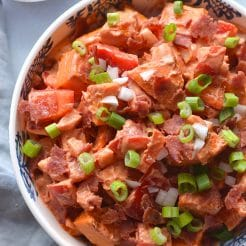 Greek Yogurt BBQ Ranch Sweet Potato Salad! Madewith a homemade Greek yogurt ranch dressing and naturally sweetened BBQsauce, this healthier potato salad is sure to be a hit at BBQ's and parties. Serve warm or cold, as a side or appetizer. Gluten free + Low Calorie