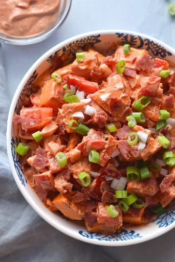 Greek Yogurt BBQ Ranch Sweet Potato Salad! Made with a homemade Greek yogurt ranch dressing and naturally sweetened BBQ sauce, this healthier potato salad is sure to be a hit at BBQ's and parties. Serve warm or cold, as a side or appetizer. Gluten free + Low Calorie