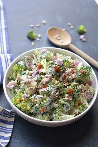 Healthy Greek Yogurt Broccoli Salad! A deliciously sweet salad with crunchy broccoli, bacon and more! No baking required. Just stir, chill and eat. The perfect warm weather salad that's higher in protein and good for you. Gluten Free + Low Calorie