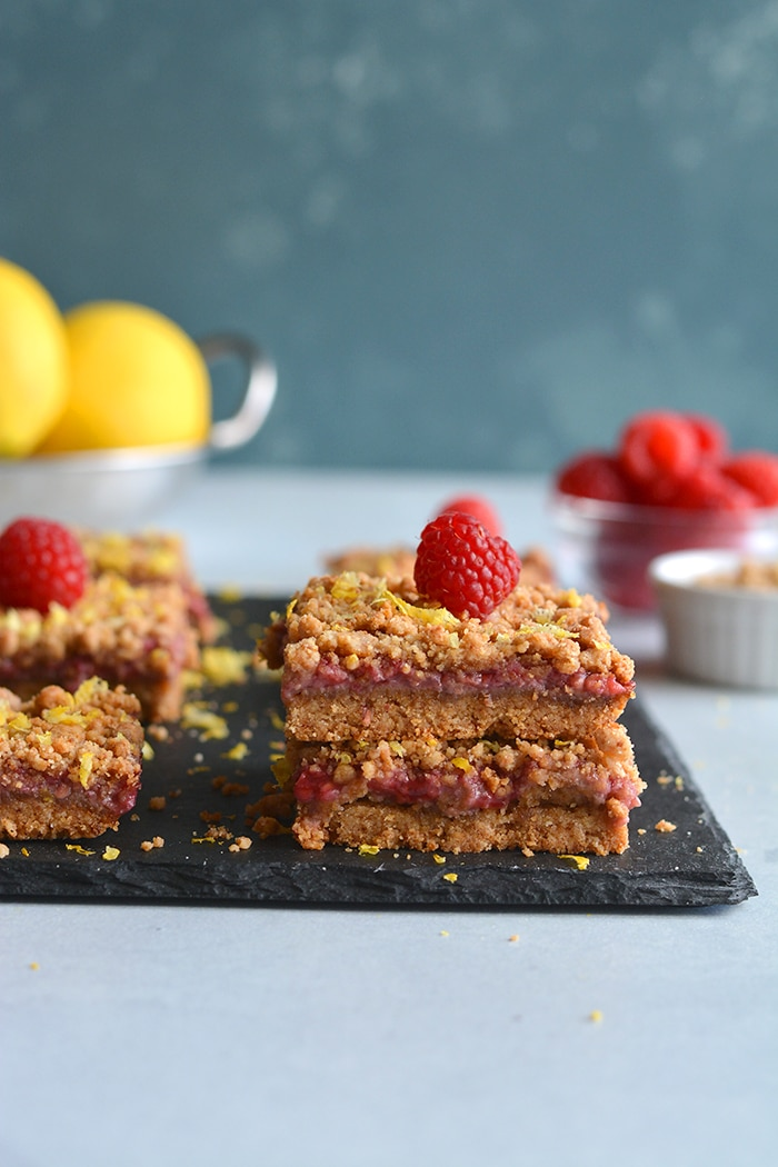 Paleo Vegan Raspberry Crumb Bars! Dairy-free, made with almond flour and wholesome ingredients! A truly addicting grain-free dessert that's good for you. Gluten Free + Low Calorie + Vegan + Paleo