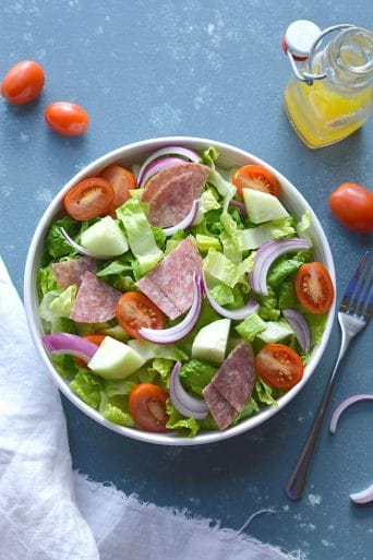 This Low Carb Italian Chopped Salad features crisp summer veggies, salami and a lighter, homemade Italian Dressing. A healthier side salad or summer meal that's mouthwateringly good! Low Carb + Paleo + Gluten Free + Low Calorie