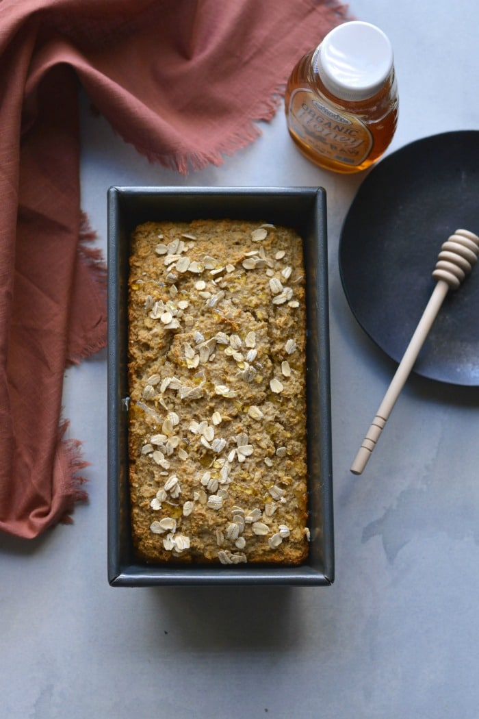 Gluten Free Honey Oat Bread made flourless with simple ingredients and lightly sweetened with honey. A delicious gluten free bread made in one bowl. Gluten Free + Low Calorie