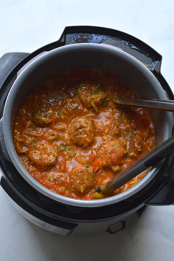 Instant Pot Spaghetti and Meatballs! A delicious one pot meal with chicken meatballs and a homemade tomato sauce. A lighter and healthier meal made in a pressure cooker with gluten free chickpea spaghetti. Gluten Free + Low Calorie