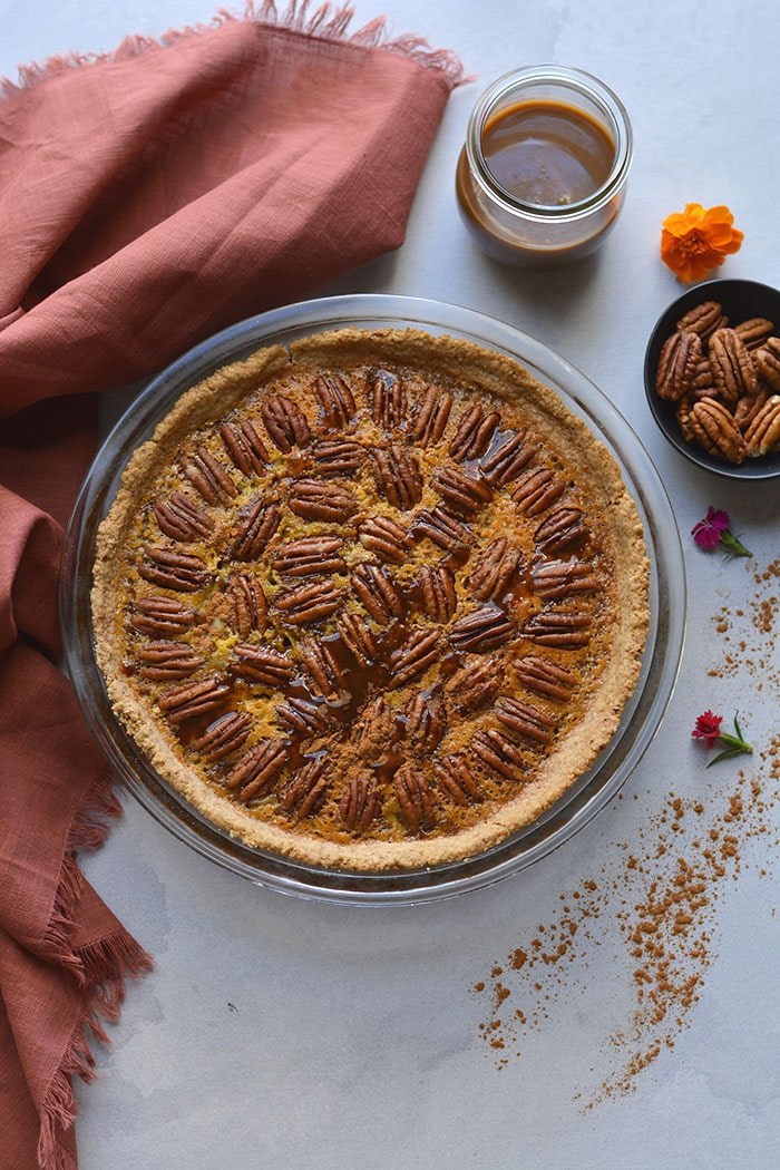 Healthy Caramel Pecan Pie! The best pecan pie made lower in sugar, lightener with less fat topped over a super simple 3 ingredient gluten free crust. The only pie you will ever want to make! Gluten Free + Low Calorie