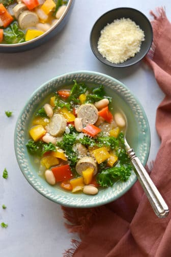 Healthy Kale Sausage Pepper Soup! An easy 30 minute one-pot meal with nourishing vegetables, beans and chicken sausage. High in fiber and protein. Gluten Free + Low Calorie