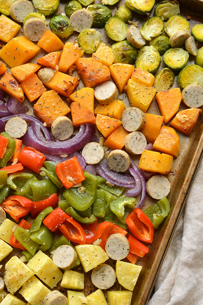 Sheet Pan Sausage and Veggies! Sugar free sausage, Brussels sprouts, butternut squash, sweet potato, red pepper and onion baked together on a sheet pan. A quick, healthy and filling 30-minute meal. Paleo + Gluten Free + Low Calorie