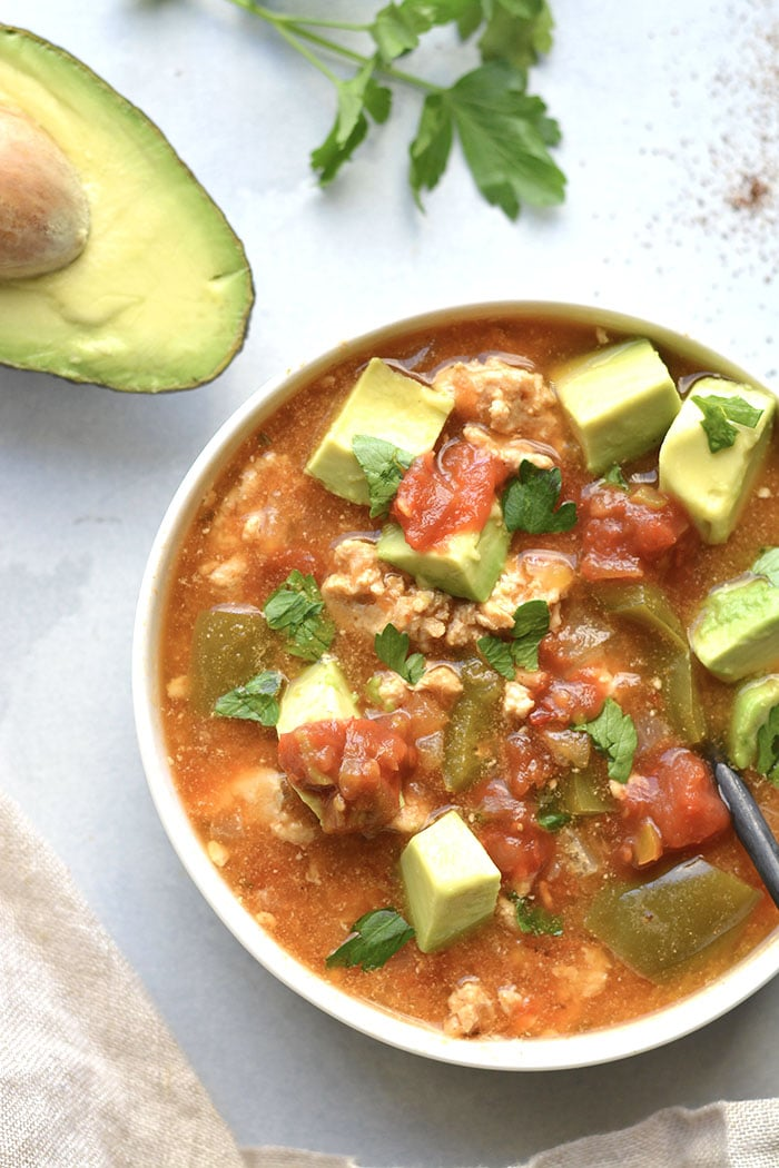 Instant Pot Taco Soup made lighter with healthy, real food ingredients. Sour creams makes this easy soup recipe creamy and it's ready in just 30-minutes in a pressure cooker. Low Carb + Gluten Free + Low Calorie