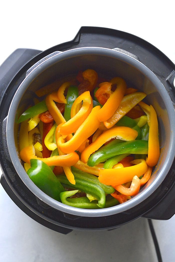 This Instant Pot Chicken and Peppers recipe is an easy 30-minute meal made with just 4 ingredients. Flavorful, low in calories and big on taste! Serve over rice, pasta, cauliflower rice or over a salad. A quick and versatile weeknight meal!Gluten Free + Low Calorie + Paleo