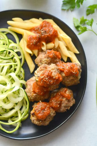 Skinny Italian Turkey Meatballs are a nutritious and lighter twist on an Italian classic dish. Made with lean turkey and herbs, they're the perfect dinner! Paleo + Low Carb + Low Calorie + Gluten Free