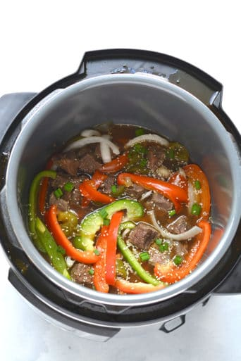 Healthy Steak & Peppers is a delicious Instant Pot meal, full of protein, nutrients and lower in calories. The key to its flavor lies in the easy marinade!