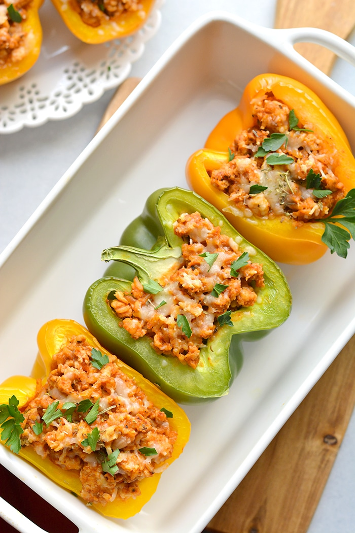 Italian Chicken Stuffed Peppers are a simple low calorie dinner to make! A delicious and hearty mixture of chicken, rice, pizza sauce and seasonings. These peppers are great for meal prep and reheat perfectly. Low Calorie + Gluten Free