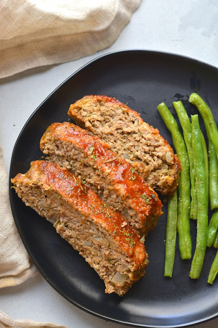 Healthy Turkey Meatloaf baked on a sheet pan. This easy low calorie dinner recipe is simple to make, egg free, hearty, gluten free and family approved! Low Calorie + Low Carb + Gluten Free