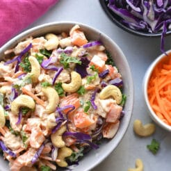 Healthy Cashew Chicken Salad made low calorie with Greek yogurt, bell peppers and cabbage. A healthy recipe that is mayo free and egg free. A great make ahead lunch to meal prep! Gluten Free + Low Calorie