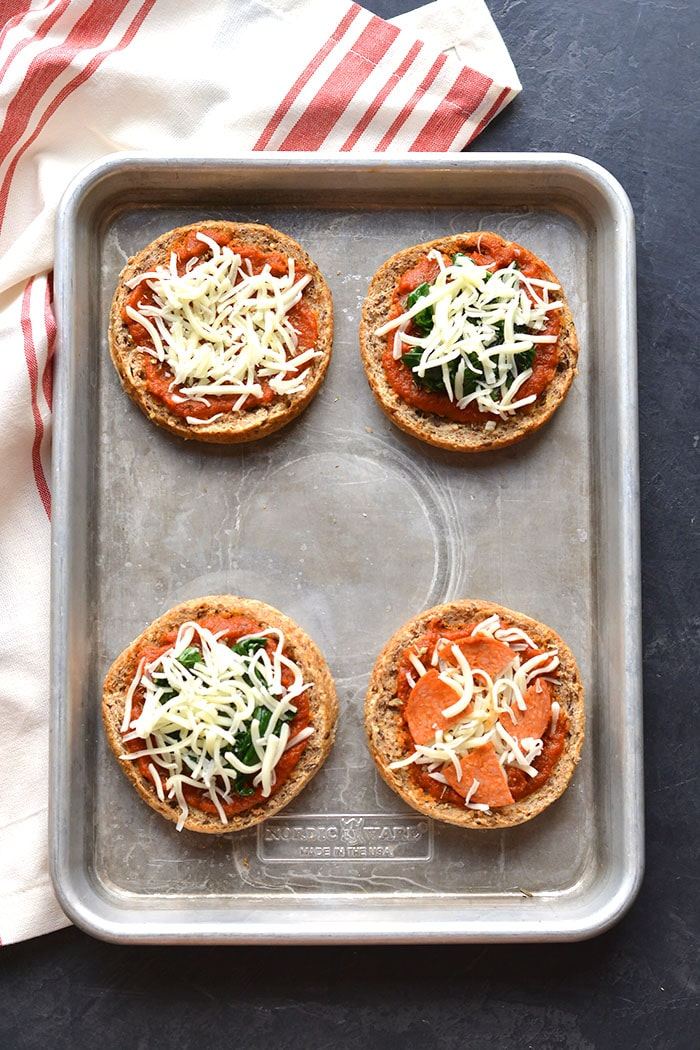 Low Calorie English Muffin Pizza is a healthy way to get your pizza fix! Top with your favorite toppings and enjoy healthy pizza in under 4 minutes. Low Calorie + Gluten Free