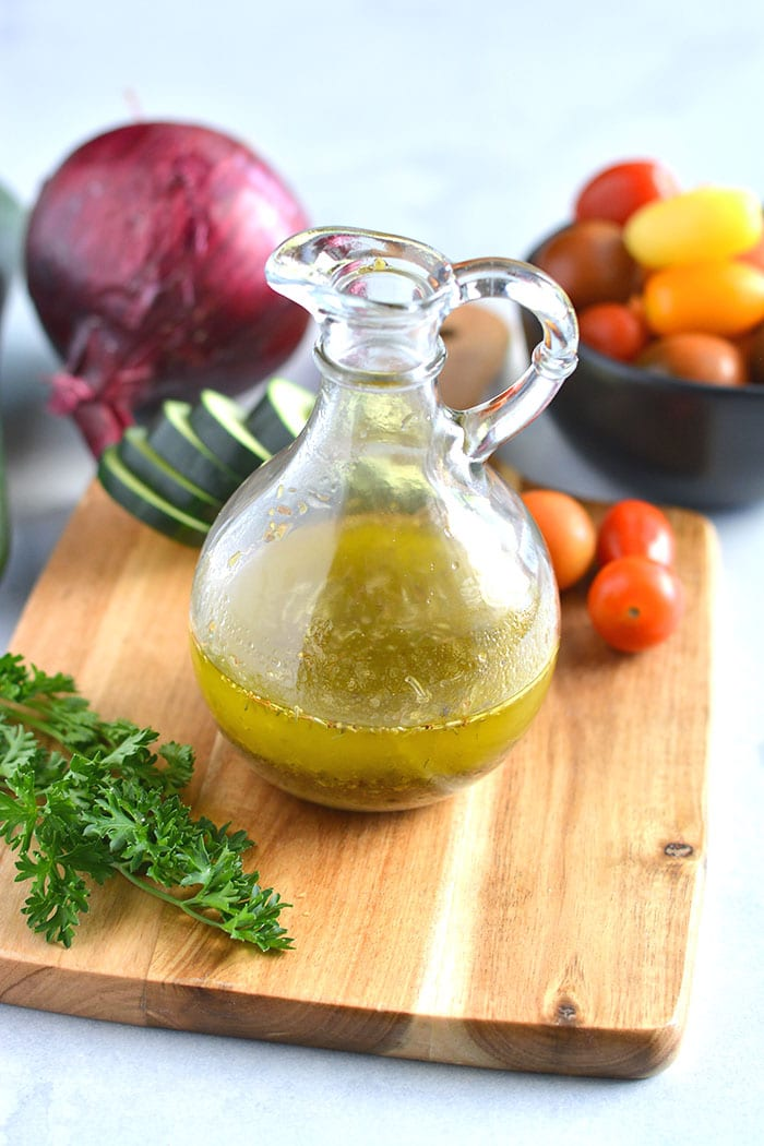 Healthy Italian Dressing is a low calorie, quick and easy salad dressing recipe! Made with Mediterranean ingredients, this healthy dressing is a favorite!