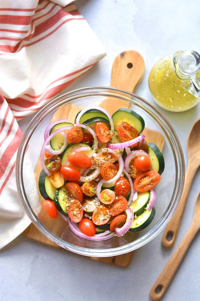 Healthy Tomato Cucumber Salad is a low calorie salad with Italian dressing. Simply toss together, chill and serve! Great as a side salad, snack or appetizer. Low Calorie + Low Carb + Gluten Free + Paleo + Vegan