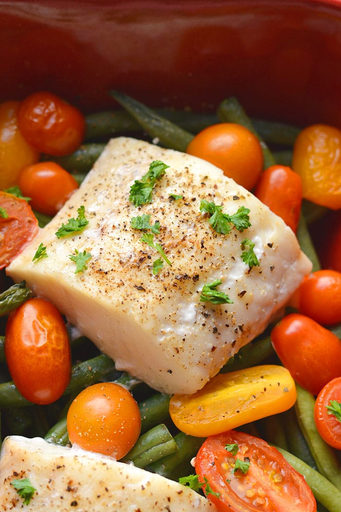 Healthy Baked Halibut with Italian flavor, lemon, tomatoes and green beans. A simple fish dinner that's tasty and effortless to make! Low Calorie + Low Carb + Gluten Free + Paleo