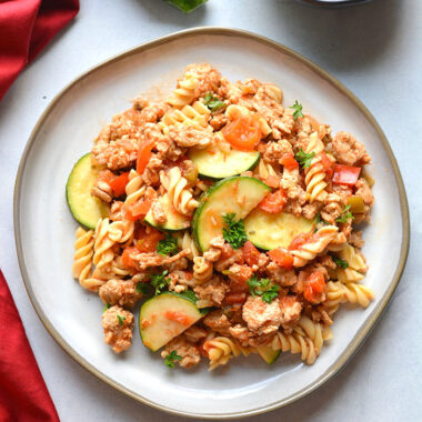 Healthy Taco Pasta is a low calorie dinner made with chickpea pasta, chicken, vegetables and salsa. High in protein and fiber, this family approved meal is healthy and easy to make! Gluten Free + Low Calorie