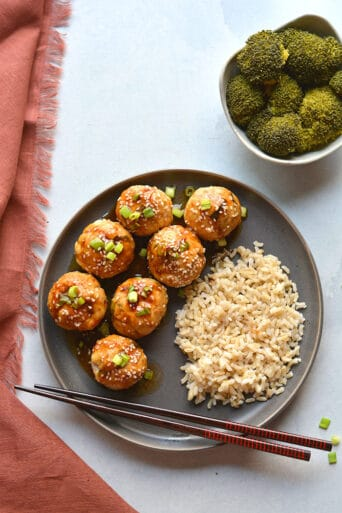 Healthy Asian Meatballs are a low calorie meal made with a sweet chili glaze. An easy and nutritious meatball recipe everyone will love!