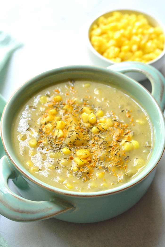 Healthy Corn Chowder made low calorie and creamy without cream using cauliflower to thicken it. A lightened up chowder that's dairy free, delicious and simple! Gluten Free + Vegan + Low Calorie