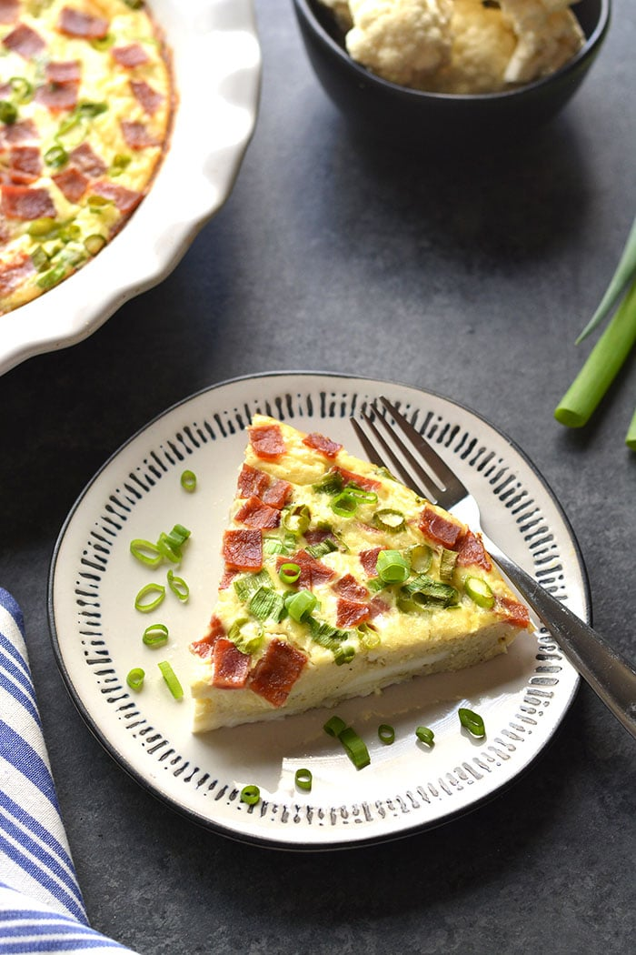 Healthy Quiche Lorraine is made crustless and replaces cauliflower the cream for a low calorie quiche Lorraine that's healthy and tasty! Gluten Free + Low Calorie + Paleo + Low Carb