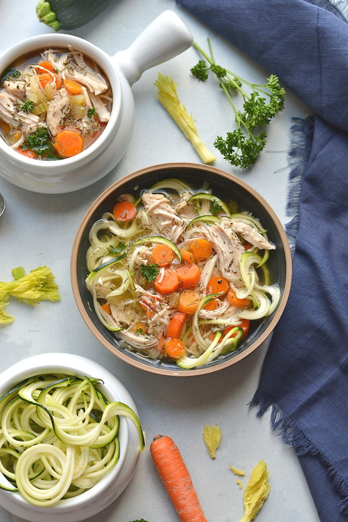 chicken soup with zucchini noodles in a bowl
