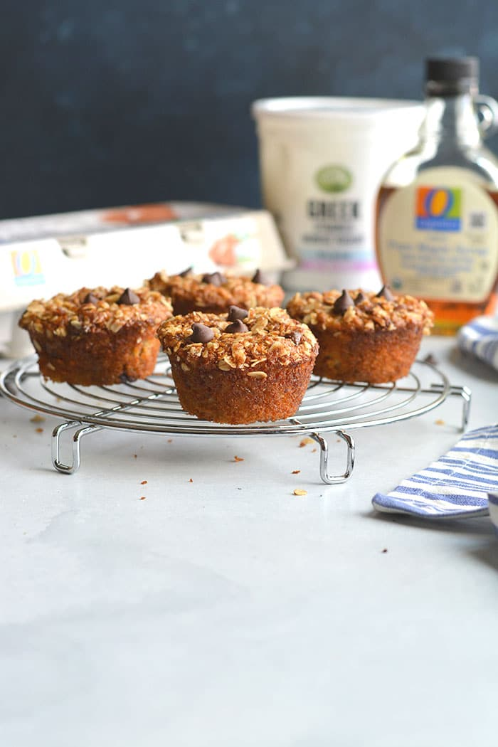 Healthy Greek Yogurt Muffins are low calorie chocolate chip muffins made with gluten free oats. Topped with a cinnamon streusel, they are a perfectly portioned snack! Gluten Free + Low Calorie
