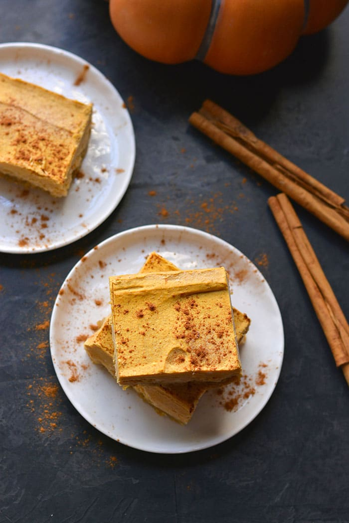 Healthy Pumpkin Cheesecake Bars is a low calorie cheesecake dessert recipe made higher protein and with a gluten free crust! Gluten Free + Low Calorie