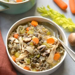 Healthy Turkey Wild Rice Soup is perfect for Thanksgiving leftover turkey! A low calorie meal that's naturally gluten free and veggie packed. Low Calorie + Gluten Free