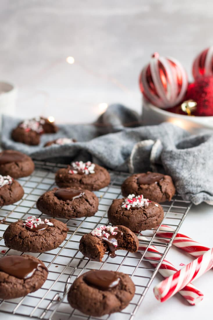 Healthy Chocolate Thumbprint Cookies made low calorie and gluten free are a delicious holiday cookie recipe with peppermint sprinkles on top! Gluten Free + Low Calorie