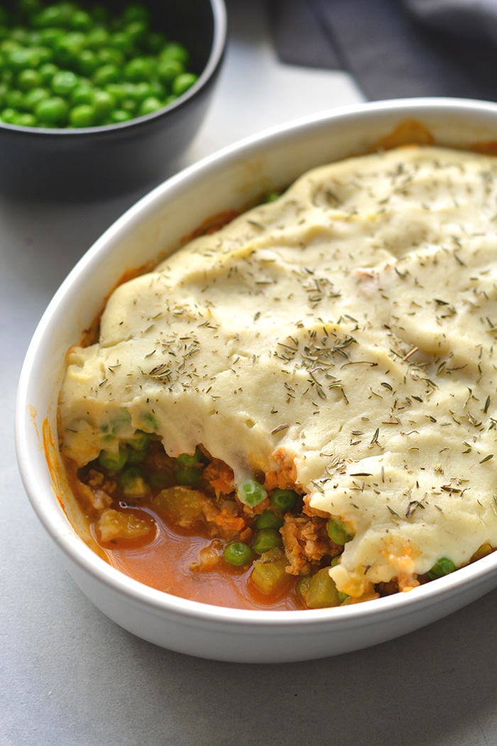 Healthy Shepherd's Pie is a low calorie recipe that's lower in carbs, high in protein and fiber. Made with a delicious roasted garlic cauliflower top and a lighter filling a for a filling and comforting winter meal. Low Calorie + Gluten Free + Paleo