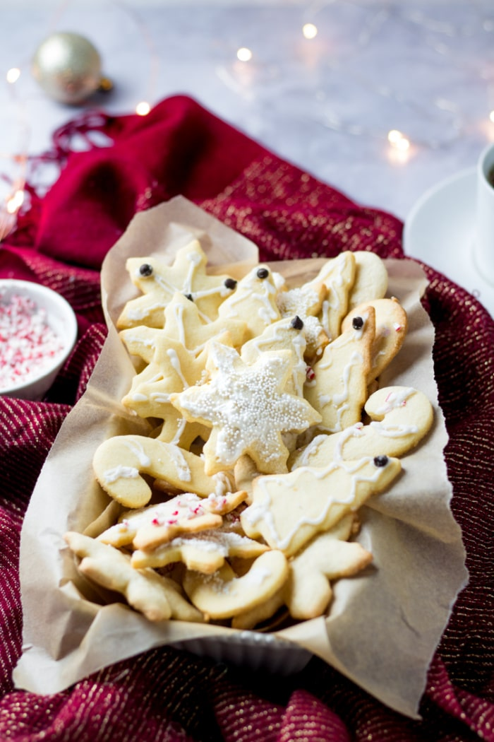 Healthy Sugar Cookies made low calorie, gluten free with an easy sugar free icing! A simple sugar cookie recipe that's lighter and healthy. Gluten Free + Low Calorie