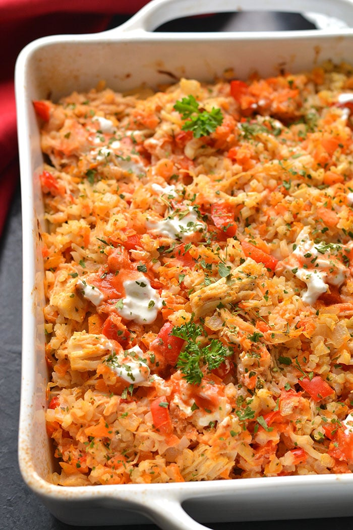 Healthy Buffalo Chicken Casserole is baked buffalo chicken recipe with cauliflower rice. A super simple and delicious one pan meal that is low calorie, low carb, gluten free, Paleo and Whole30 friendly.