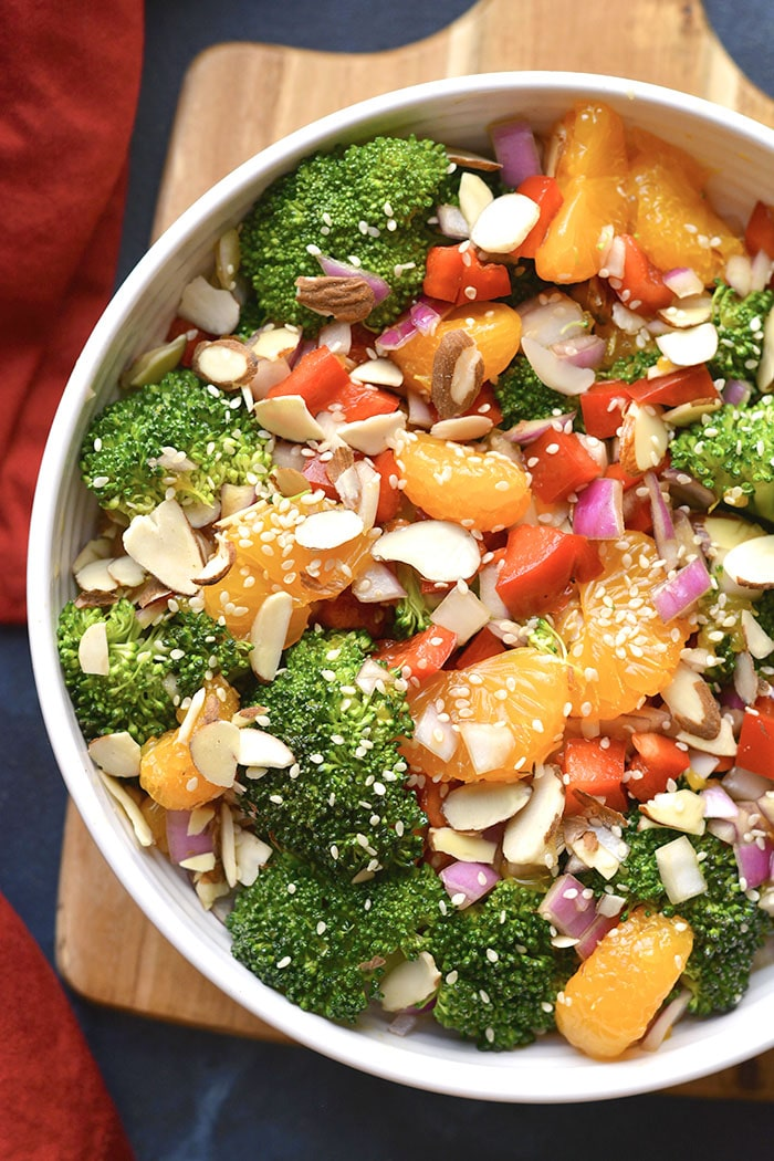 Healthy Asian Broccoli Salad is a delicious low calorie broccoli salad mixed with almonds, veggies, mandarin oranges and an Asian marinade. Served chilled for a super healthy side salad or appetizer!