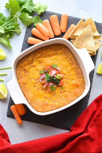 Healthy Pinto Bean Dip recipe is made low calorie and higher in protein. A simple and delicious healthy bean dip recipe that ready in 15-minutes. Great served as a snack or party appetizer!