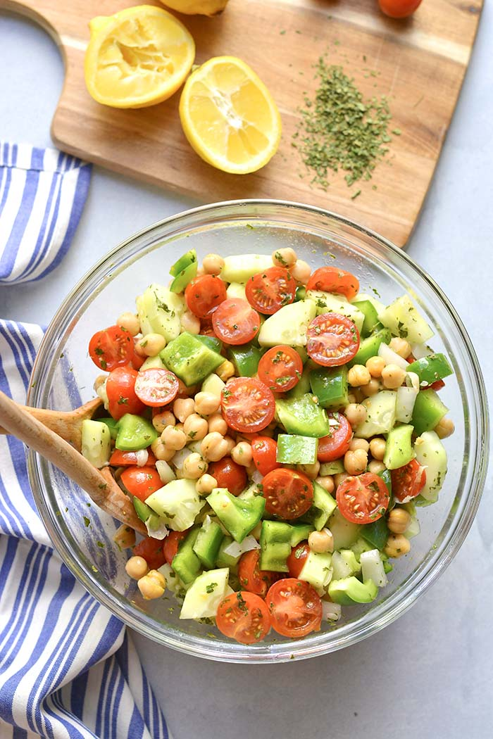 Healthy Chickpea Tomato Cucumber Salad is a low calorie side dish that's easy to make, delicious and doubles as an appetizer. A light and filling side salad that goes easily with any meal and great for warm weather eating.