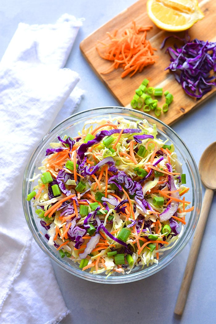 Healthy Low Calorie Coleslaw made with Greek yogurt instead of mayo and no added sugar. This simple, healthy coleslaw recipe is bursting with vegetables and nutrients while being lower in calories and fat.