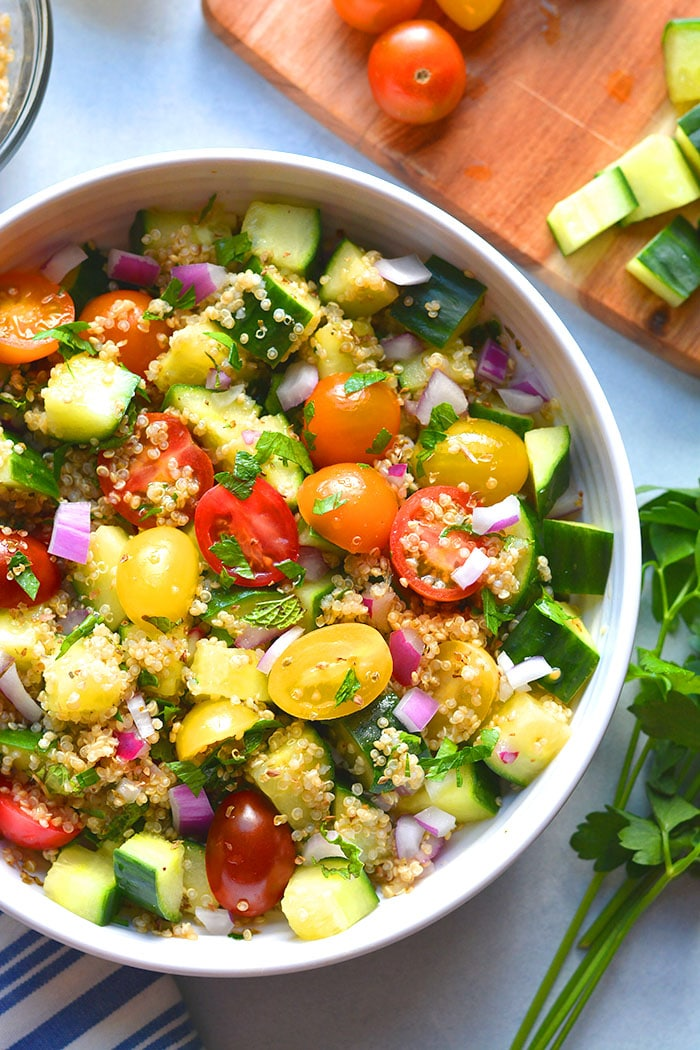 This Healthy Tabbouleh Quinoa Salad has quinoa instead of bulgur. A low calorie Mediterranean salad recipe packed with fresh vegetables.