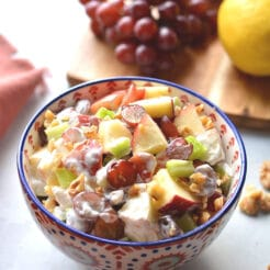 Healthy Waldorf Salad is made low calorie with a creamy, lemon Greek yogurt sauce with no added sugar and no mayo. A healthy side dish or appetizer that's easy to make, naturally gluten free and delicious! Gluten Free + Low Calorie