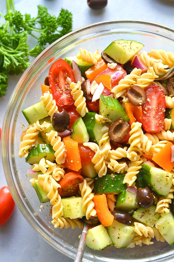 This Low Calorie Pasta Salad is loaded with vegetables and chickpea pasta. Made light with healthy ingredients this tasty, gluten free and dairy free pasta salad recipe is one you will make time and again. Perfect for summer eating as a side dish or appetizer!