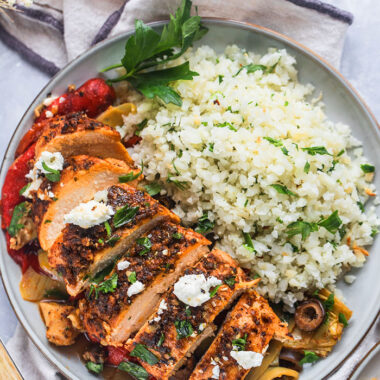 Healthy Greek Chicken Casserole is a low calorie, Mediterranean meal paired with vegetables and cauliflower rice. A gluten free recipe with Greek flavors that tastes amazing!