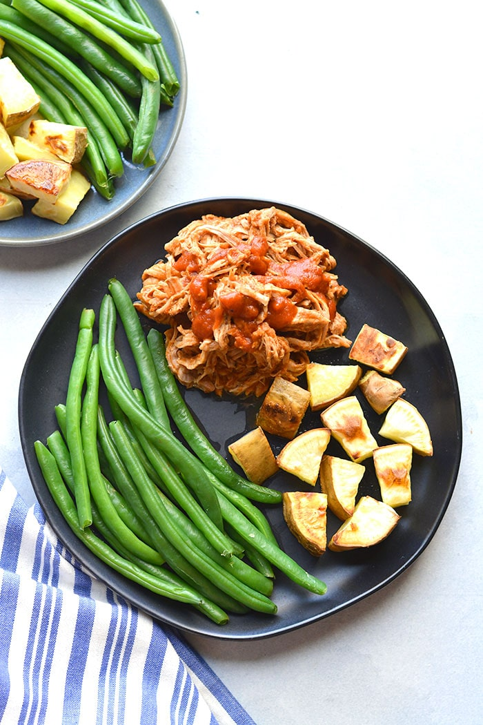 Healthy Crockpot Pulled Pork is a low calorie, low carb recipe. Perfect for easy meals and meal prep. Serve over a salad, in lettuce wraps, in grain free buns, over cauliflower rice or brown rice. A simple, slow cooker meal that takes little effort and tastes delicious!